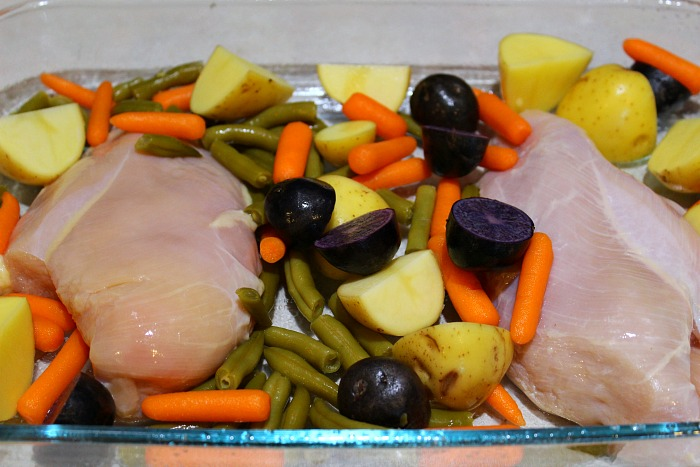 This easy chicken and vegetable bake a frugal dinner full of protein and veggies. Easy weeknight dinner the family loves to eat.
