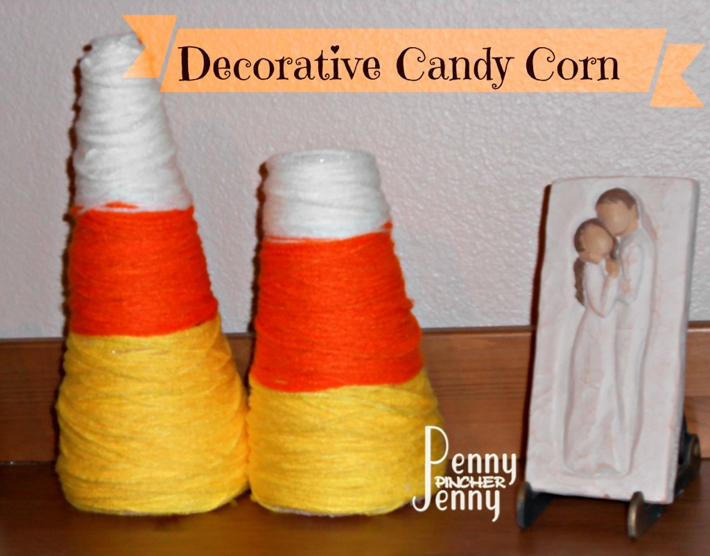 Candy Corn Craft made out of styrofoam cones and yarn is a great frugal craft to make with the whole family! Plus since most supplies can be gotten at Dollar stores so it's a frugal way to decorate your home for the fall as well.