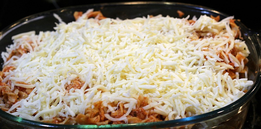 This Chicken Parmesan Cheese Bake Casserole is perfect for the whole family!! Throw together pasta, sauce, chicken, and cheese for a weeknight dinner!