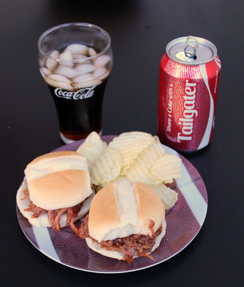 These Coca Cola Pulled Pork BBQ Sliders are a great way to tailgate!! Plus with being in the crock pot super easy to make!