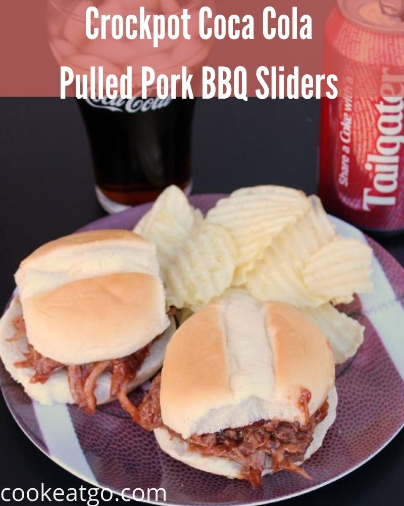 These Coca Cola Pulled Pork BBQ Sliders are perfect for tailgating! Easy to make in the crockpot and full of flavor to make the whole crowd happy!
