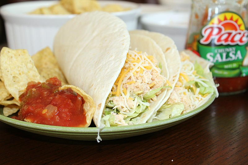 These2 Ingredient Crock Pot Chicken Tacos are the perfect dinner for a crazy school night. My kids loved these and they were super easy to make.