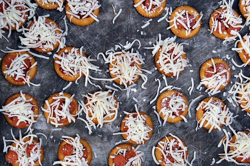 These Ritz Cracker Pizzas are perfect to make for quick get togethers or tailgating!! Plus they are super easy to make as well!!