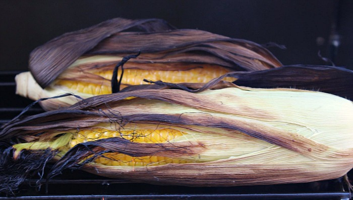 Grilled Corn On The Cob In Husk is one of our favorite sides during grilling season!! So easy to do and so full of flavor! Easy to change up the flavor