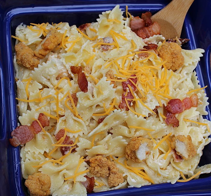 This Popcorn Chicken Pasta Salad is perfect to take to a get together or BBQ!! Combine ranch, popcorn chicken, and bacon into a pasta salad a sure fire hit!