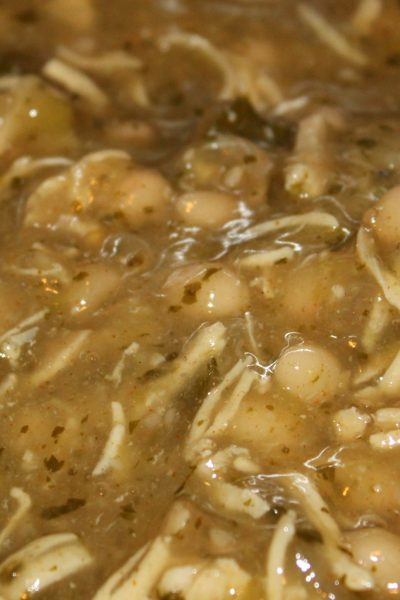 This Slow Cooker White Chicken Chili is the perfect way to warm up during the cold winter rmonths! Plus the leftovers make for a perfect lunch the next day!