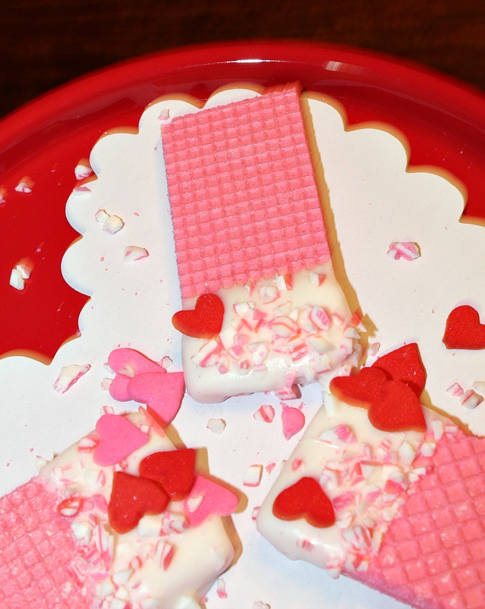 These Easy Chocolate Dipped Wafer Cookies are perfect to make for Valentine's day or any other holiday! They take hardly any time to make and taste amazing.