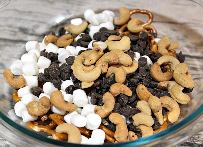 This Easy Kid Trail Mix is a great way to make a custom snack for your kids! Plus it's a great way to save money on picking up snacks while on the go.