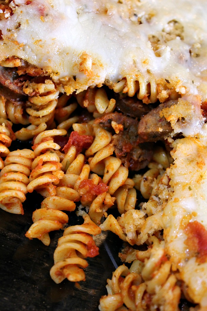 Easy Cheesy Sausage Pasta Bake is the perfect quick recipe to whip up for dinner!! Full and hearty it will fill everyone up. Plus it's a great casserole!