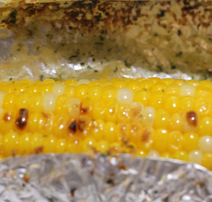 Grilled Corn On The Cob In Foil is one of the best ways to cook a summer favorite vegetable corn on the cob!! Full of flavor, easy to make a new way how to make corn on the cob, even better it won't make the house hot since it's outside on the grill.