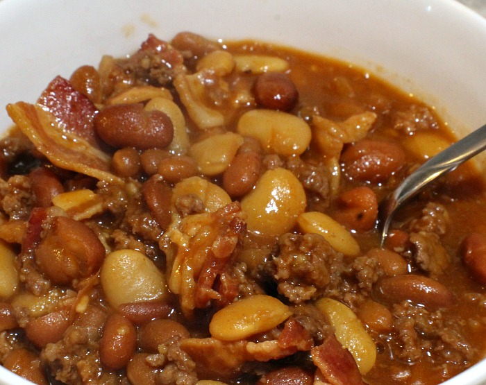Crock Pot Loaded Baked Beans are perfect for any time of year. Just drop everything in the crock pot stir, perfect for picnics, tailgating, and potlucks