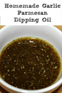 This Homemade Garlic Parmesan Dipping Oil is amazing for dipping pizzas in and breads! Plus since you make it at home it's a fraction the cost of buying it!