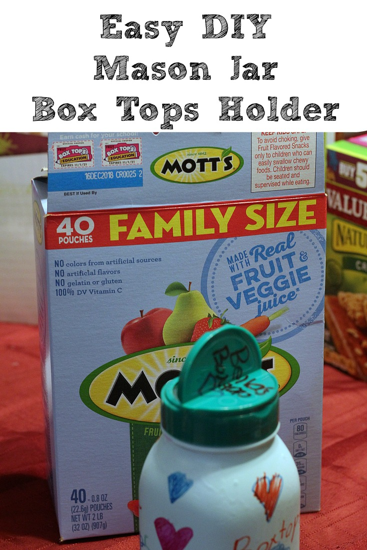 This Easy DIY Mason Jar Box Tops Holder is the perfect way to create a fun container for Box Tops!! Plus if you use a parmesan cheese topper you can easily flip it open to feed in new Box Tops as well!