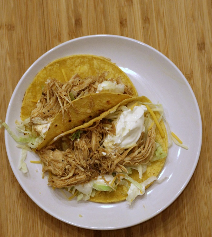 These Instant Pot Shredded Chicken Tacos are the perfect way to have a tasty dinner on the table in no time! Plus there is no prep work or watching for the chicken to cook! Tacos are a family favorite budget-friendly weeknight dinner. They are perfect for Taco Tuesday!!!