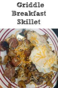 This Camping Griddle Breakfast Skillet is perfect to make while camping or even at home! Easy to make with potatoes, eggs, onions, bacon, and cheese!