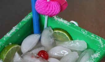 These Easy Margarita Bucket Drinks are perfect summer time drink to make or for tailgating! Garnish to change up the flavor as well!