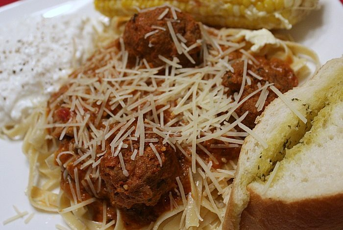 These Homemade Meatballs In Spaghetti Sauce are perfect for a family dinner night! Rolling meatballs is the perfect way to get kids in the kitchen cooking!