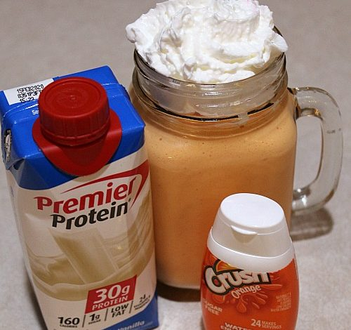 This Orange Creamsicle Protein Shake Recipe is the perfect way to satisfy a sweet tooth! Plus only three ingredients to stay on track!