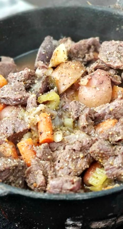 This Dutch Oven Beef Stew Recipe is perfect to make either in the oven or on a campsite! Easy ingredients slow cooking adds amazing flavor and comfort food.