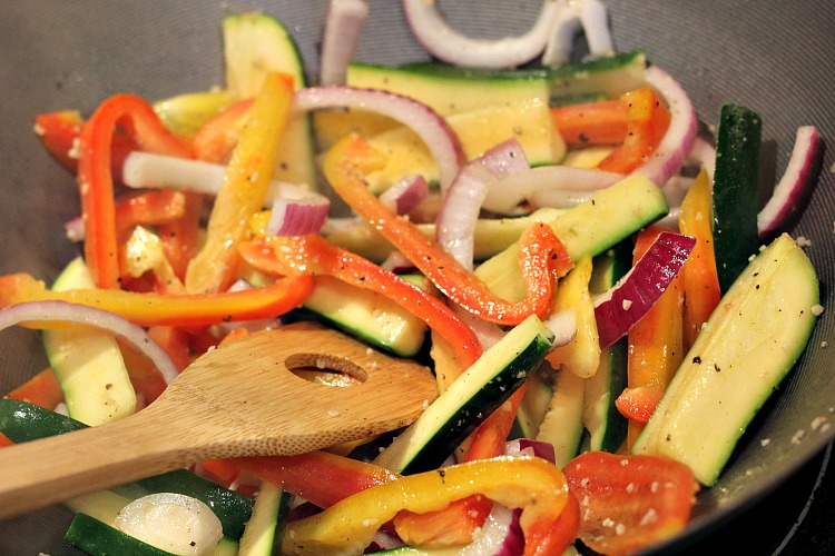 This Vegetable Stir Fry Recipe is easy to whip up in a wok or pan! Make perfect crisp vegetables as a side or add in pasta and meat to make a meal!