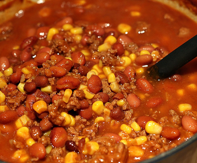 This Dutch oven Beef Chili Recipe is a huge hit with the whole family!! Just dump everything in and cook on low for a cozy comfort dinner.