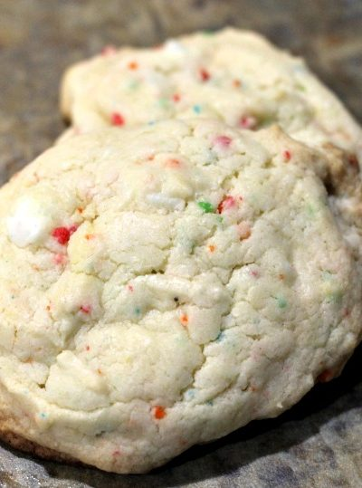 This Rainbow Chip Cake Mix Cookies Recipe is made with only four ingredients! So easy to make and the confetti baking chips turns up the flavor!